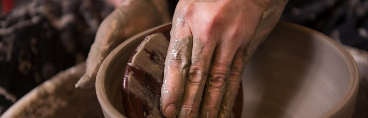 Image if someone making pottery bowl